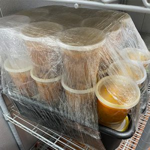 soup containers wrapped for pickup